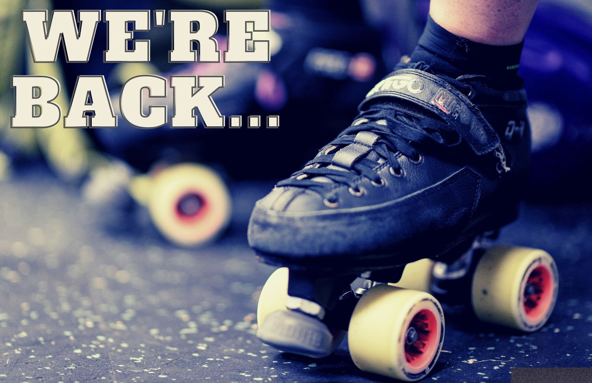 """Skates with the words """"We're back"""""""